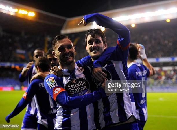 Deportivo La Coruna's midfielder Luis Alberto celebrates with teammate midfielder Lucas Perez after scoring a goal during the Spanish league football...