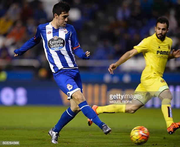 Deportivo La Coruna's midfielder Luis Alberto touches the ball to score during the Spanish league football match RC Deportivo de la Coruna vs...