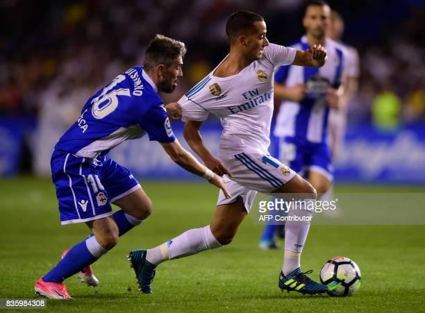 Deportivo La Coruna's Portuguese defender Luisinho vies with Real Madrid's midfielder Lucas Vazquez during the Spanish league footbal match RC...