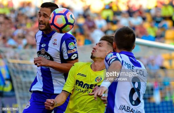 Deportivo La Coruna's Romanian forward Florin Andone vies with Villarreal's midfielder Samuel Castillejo during the Spanish league football match...