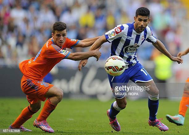 Deportivo's midfielder Juanfran Moreno vies with Valencia's defender Jose Gaya during the Spanish league football match RC Deportivo de la Coruna vs...