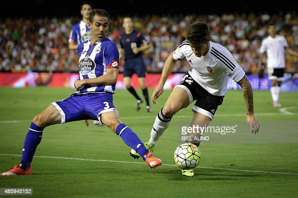 Deportivo's Spanish defender Fernando Navarro vies with Valencia's Spanish forward Santi Mina during the Spanish league football match Valencia CF vs...