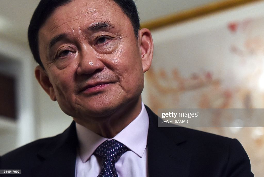 Deposed former Thai premier <a gi-track='captionPersonalityLinkClicked' href=/galleries/search?phrase=Thaksin+Shinawatra&family=editorial&specificpeople=220948 ng-click='$event.stopPropagation()'>Thaksin Shinawatra</a> answers a question during an interview in New York, on March 9, 2016. / AFP / Jewel SAMAD