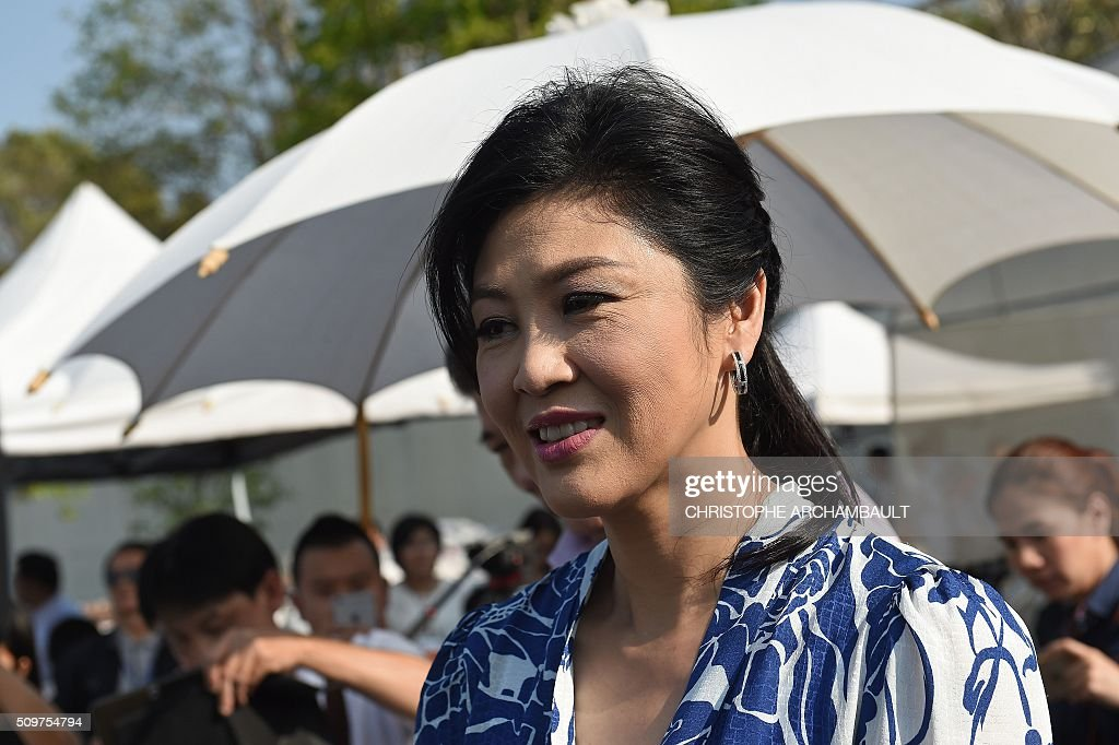 Deposed Thai Prime Minister Yingluck Shinawatra is pictured as she gives a tour of her vegetable garden to mainly foreign media who were invited at her compound in Bangkok on February 12, 2016. Barred from discussing politics by the Thai junta, ousted Prime Minister Yingluck Shinawatra opened up her Bangkok home on February 12 to talk about her new passion: vegetables. AFP PHOTO / Christophe ARCHAMBAULT / AFP / CHRISTOPHE ARCHAMBAULT