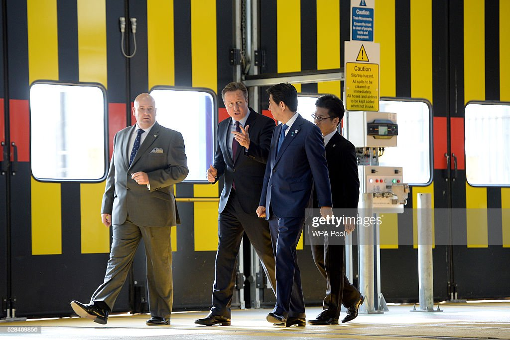 Depot manager George Staines (L), Prime Minister David Cameron and Japanese Prime Minister Shinzo Abe (2nd R) tour the Hitachi North Pole train maintenance Depot in West London on May 5, 2016 in London, England. Prime Minister Shinzo Abe is on a week-long tour of Europe and Russia ahead of hosting this month's G-7 summit. Prime Minister Abe has warned that Brexit would make the UK 'less attractive' to Japanese investors.