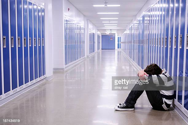 Depressed Boy in School Hallway
