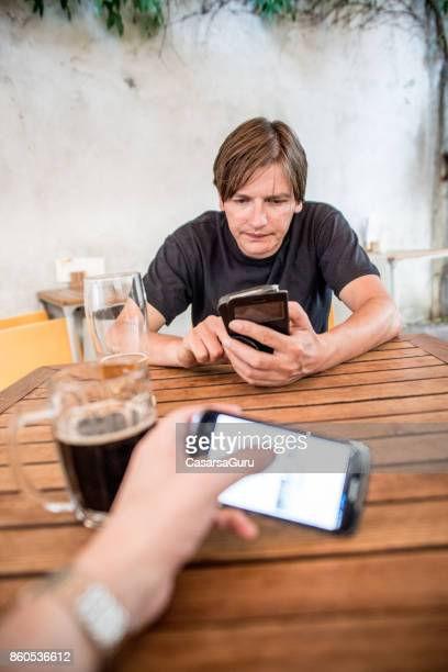 Depressed Entrepreneur Texting While Having A Drink Before Working