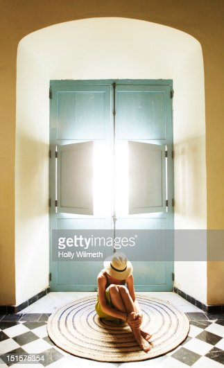 Depressed female in front of window. : Stock Photo