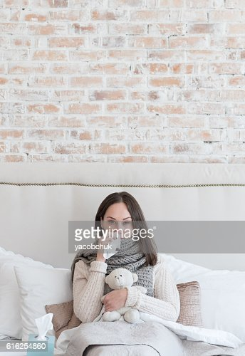 Depressed ill woman resting : Foto de stock