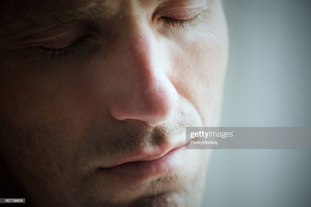 Depressed Man Crying With Eyes Closed Face Close Up Stock