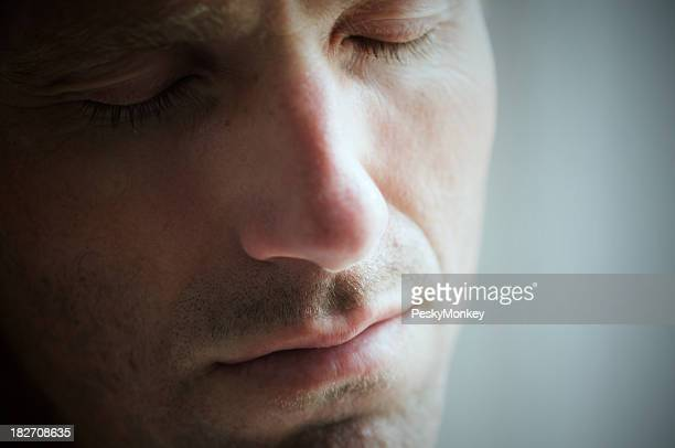 Depressed Man Crying with Eyes Closed Face Close Up