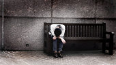 Depressed man sitting on bench