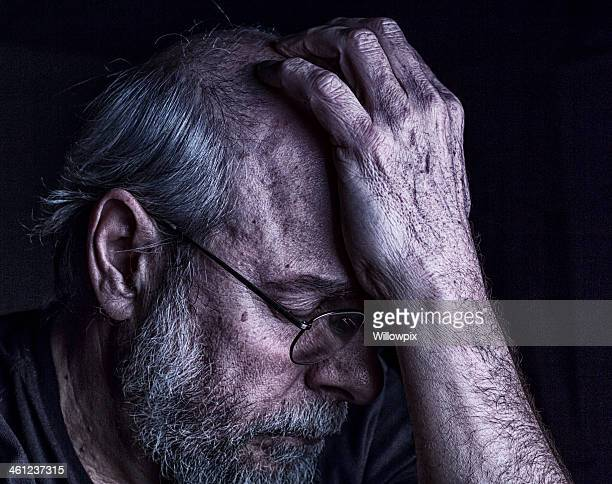 Depressed Overwhelmed Senior Man