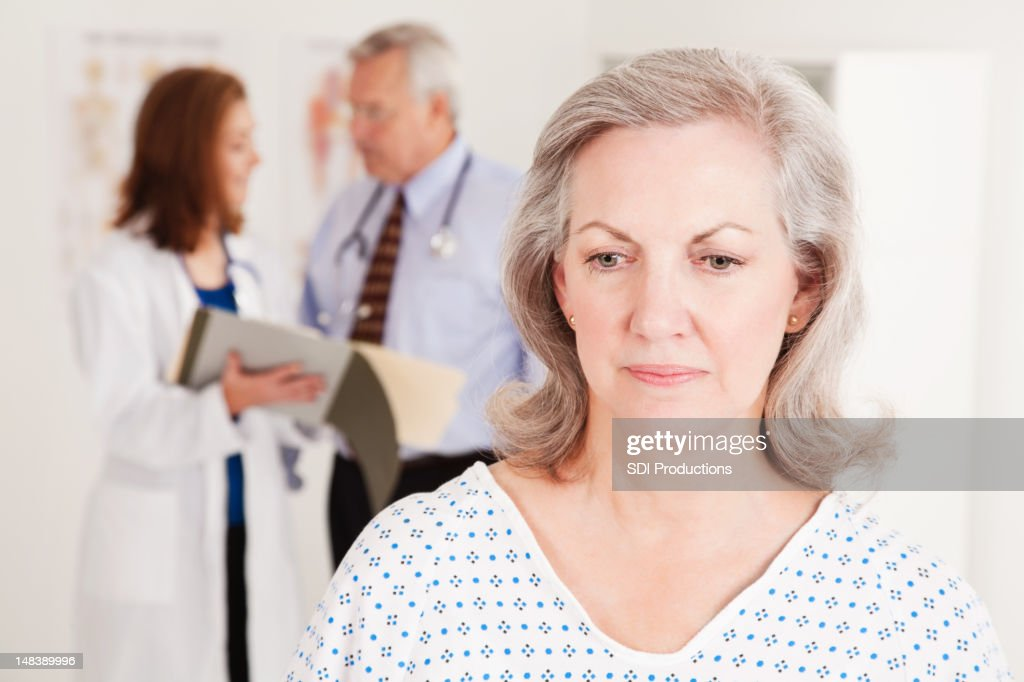 Depressed Patient At Doctor's Office : Stock Photo
