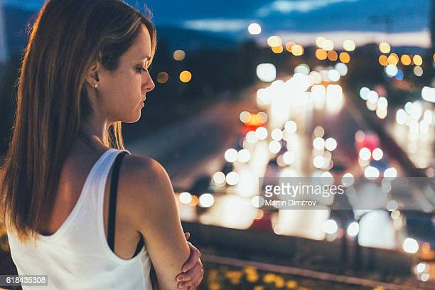 Depressed woman in the city