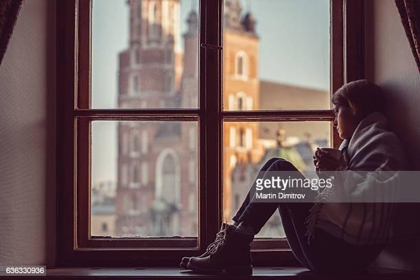 Depressed woman on the window