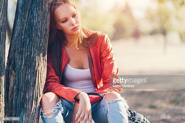 Depressed woman sitting outside