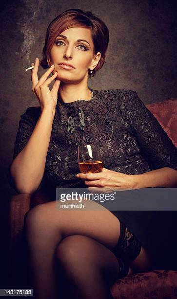 depressed woman smoking and drinking