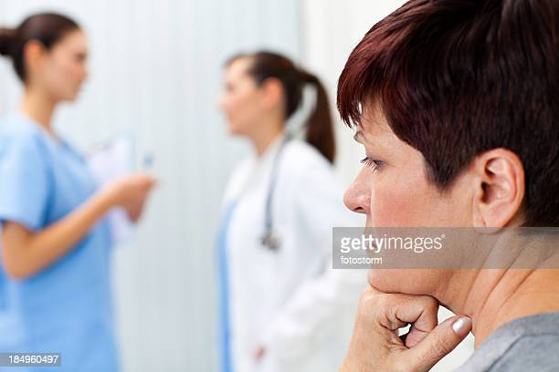 Depressed woman waiting in doctor's office