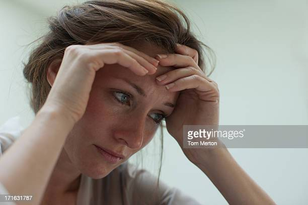 Depressed woman with head in hands