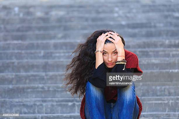 Depression and sadness in one woman on the stairs
