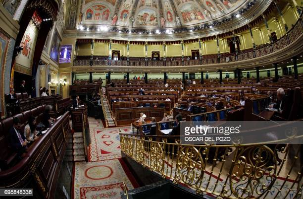 Deputies attend a debate at the Congress of Deputies in Madrid on June 14 2017 before a vote of no confidence tabled by the farleft Podemos to...