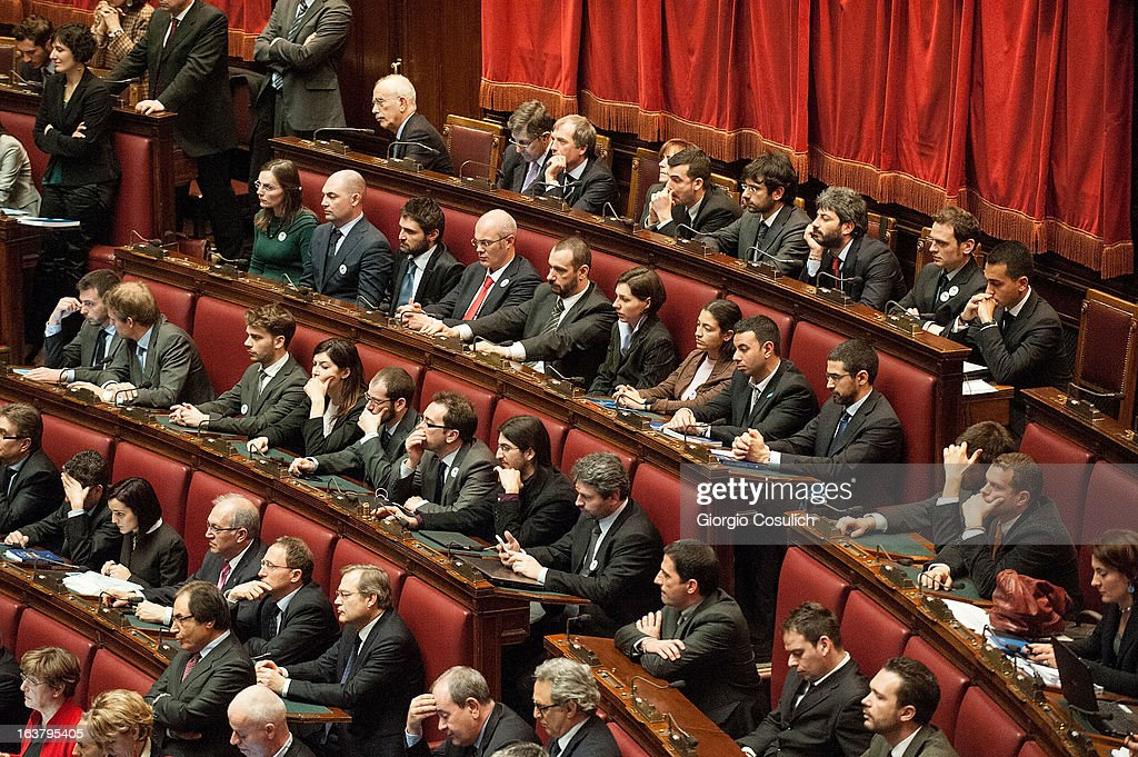 Deputies of Five Stars Movement listen at Laura Boldrini (not in pictures) as she gives a speech after being nominated the new President of the Chambers of Deputies during the second meeting of the new Italian Parliament on March 16, 2013 in Rome, Italy. The new Italian parliament, which opens the 17th Legislature, has the task of electing the President of the House of Parliament and of the Senate, before giving way to a new government.