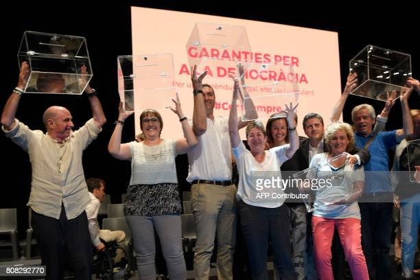 Deputies of the Catalan Parliament pose with ballot boxes after the presentation of the details of the referendum of selfdetermination of Catalonia...