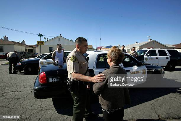 Deputies respond to a neighborhood dispute where a gun was believed to be waved around by one of the angry residents in Compton May 28 2010 Almost 10...