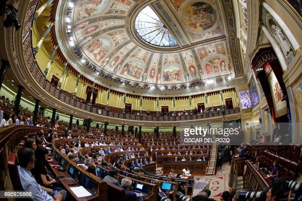 Deputies sit at the Congress of Deputies in Madrid on June 14 2017 during a vote of no confidence tabled by the farleft Podemos to denounce a series...