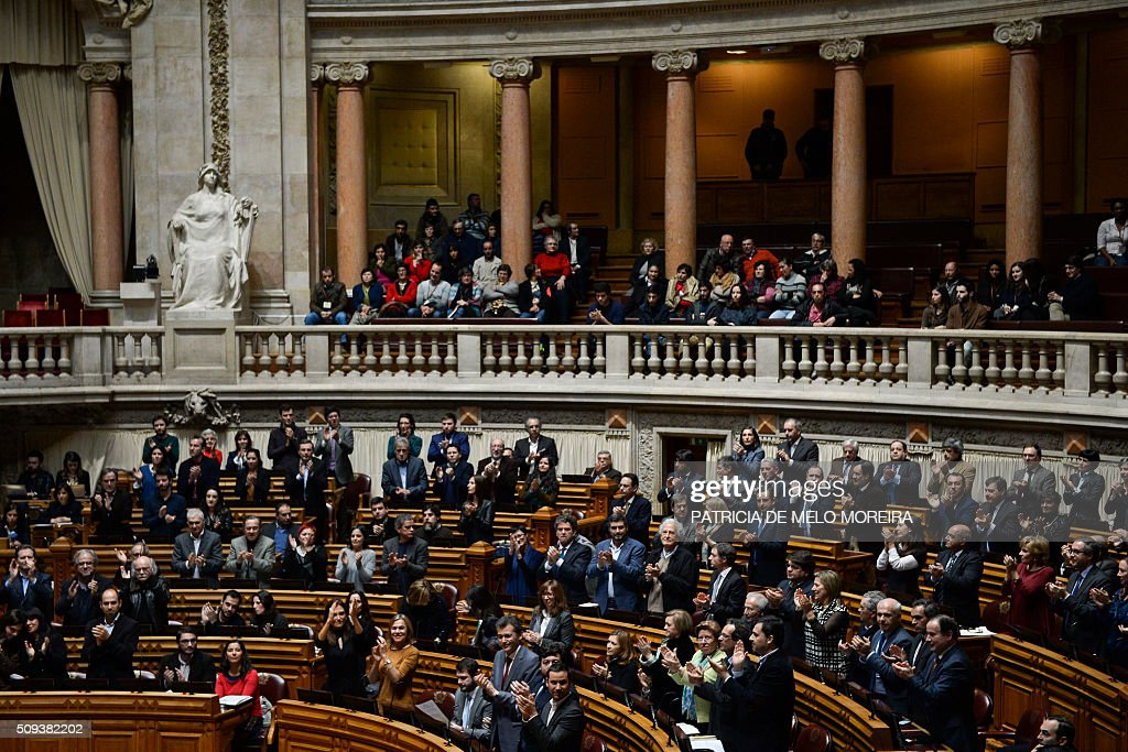 Deputies stand and clap after voting in favour of a law authorizing adoption by homosexual couples at the Portuguese parliament in Lisbon on February 10, 2016. Last January President Cavaco Silva vetoed this law but had his hand forced today with the majority of the parliament voting for the adoption of the law. / AFP / PATRICIA DE MELO MOREIRA