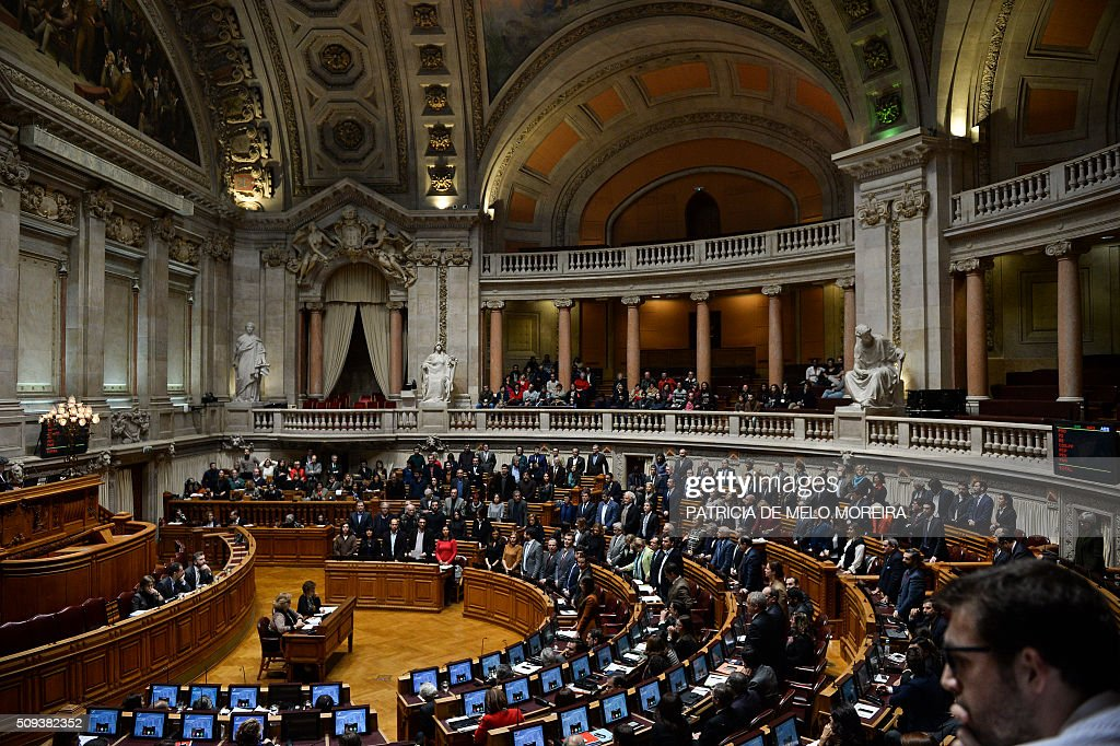 Deputies stand and vote in favour of a law authorizing adoption by homosexual couples at the Portuguese parliament in Lisbon on February 10, 2016. Last January President Cavaco Silva vetoed this law but had his hand forced today with the majority of the parliament voting for the adoption of the law. / AFP / PATRICIA DE MELO MOREIRA