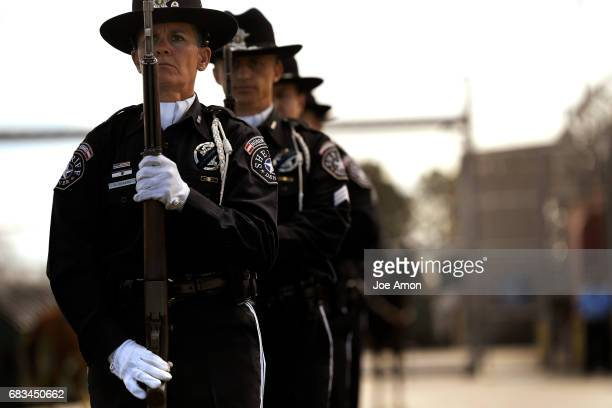 Deputy Adele Angers stands at Port Arms with the honor guard ready to fired 15 rounds in salute for officers being honored during the Denver...