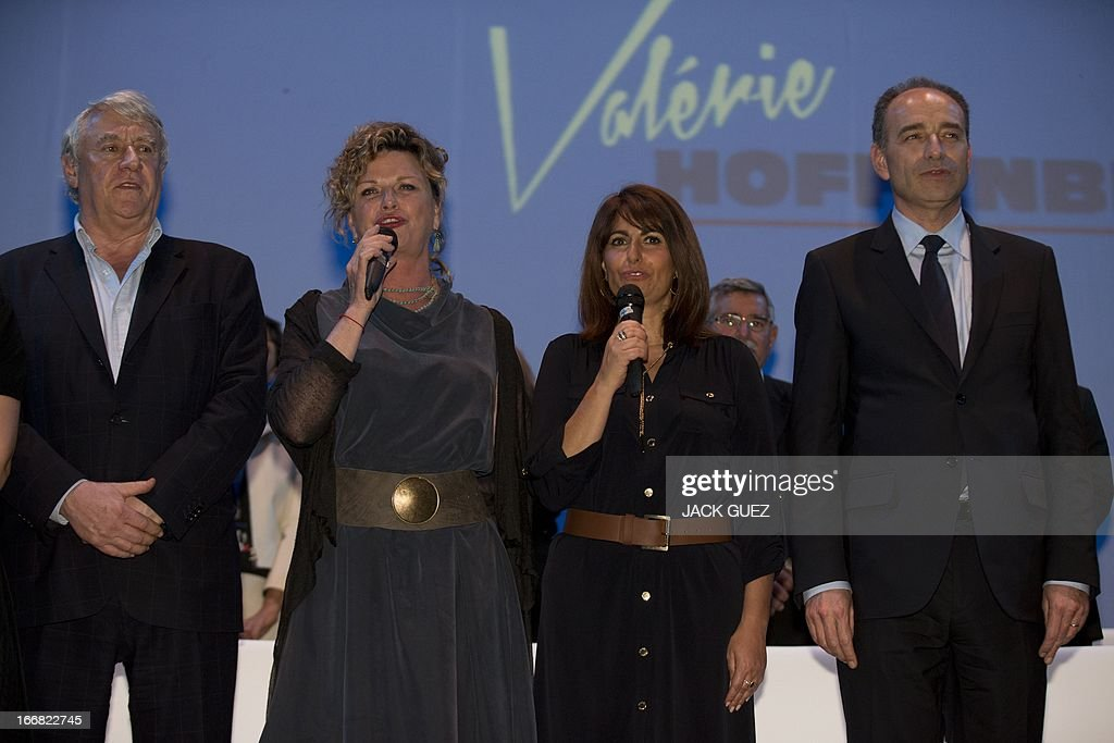 Deputy and Mayor of the 16th district of Paris Claude Goasguen, Jeane Mason, Valerie Hoffenberg and French right-wing opposition party, Union for a Popular Movement (UMP), President Jean-Francois Cope sing the French national anthem during a campaign meeting in the Mediterranean coastal city of Tel Aviv, on April 17, 2013.
