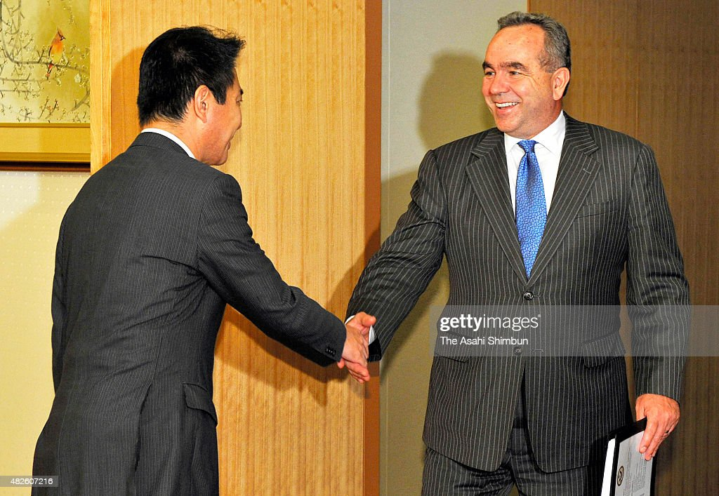 US Deputy Assistant Secretary of Defense Kurt Campbell and Japanese Foreign Minister Seiji Maehara shake hands during their meeting at Foreign...
