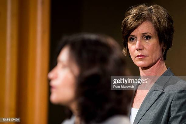 Deputy Attorney General Sally Q Yates looks on as Federal Trade Commission Chairwoman Edith Ramirez speaks during a press conference at the...