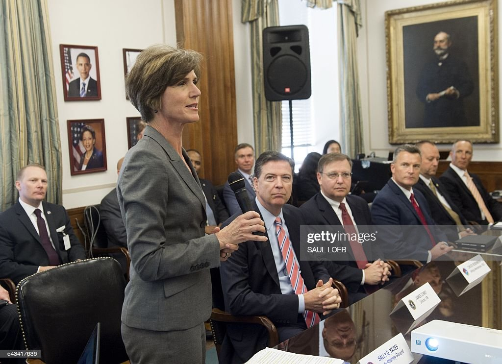 Deputy Attorney General Sally Q. Yates (L) speaks alongside FBI Director James Comey (2L) and Chuck Rosenberg (C), acting administrator of the Drug Enforcement Administration (DEA) as they attend a new Implicit Bias Training program at the Department of Justice in Washington, DC, June 28, 2016. / AFP / SAUL