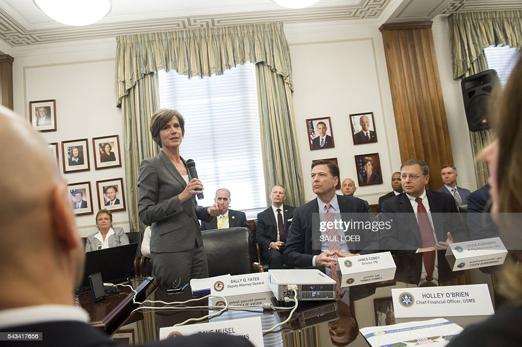 Deputy Attorney General Sally Q. Yates (L) speaks alongside FBI Director James Comey (2R) and Chuck Rosenberg (R), acting administrator of the Drug Enforcement Administration (DEA) as they attend a new Implicit Bias Training program at the Department of Justice in Washington, DC, June 28, 2016. / AFP / SAUL
