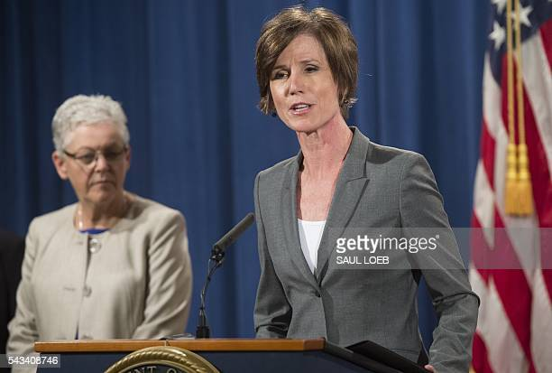 Deputy Attorney General Sally Yates speaks alongside Environmental Protection Agency Administrator Gina McCarthy during a press conference to...
