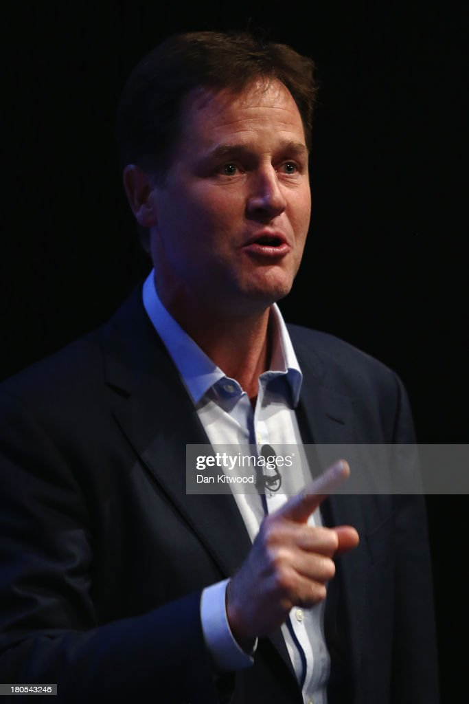 Deputy British Prime Minister and leader of the Liberal Democrats <a gi-track='captionPersonalityLinkClicked' href=/galleries/search?phrase=Nick+Clegg&family=editorial&specificpeople=579276 ng-click='$event.stopPropagation()'>Nick Clegg</a> speaks during a rally at the end of the first day of conference at the SECC, Scottish Exhibition and Conference Centre on September 14, 2013 in Glasgow, Scotland. The Liberal Democrat Autumn conference began in Glasgow today where the leader <a gi-track='captionPersonalityLinkClicked' href=/galleries/search?phrase=Nick+Clegg&family=editorial&specificpeople=579276 ng-click='$event.stopPropagation()'>Nick Clegg</a> addressed the audience during a rally this evening.