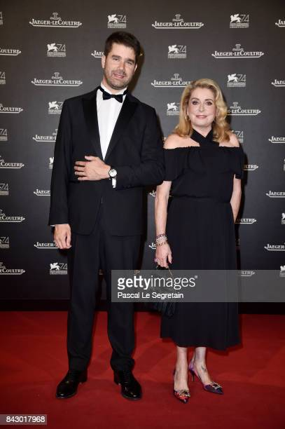 Deputy CEO of JaegerLeCoultre Geoffroy Lefebvre and Catherine Deneuve arrive for the JaegerLeCoultre Gala Dinner during the 74th Venice International...