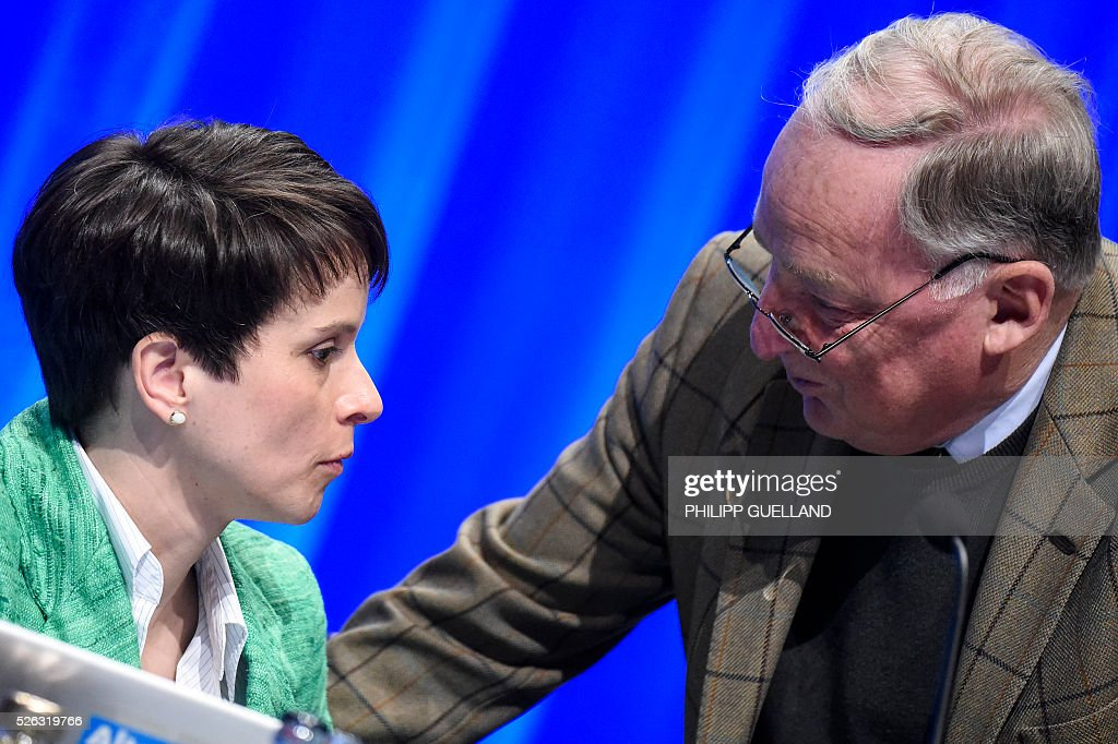 AFD deputy chairman Alexander Gauland (R) talks to the head of AFD, Frauke Petry during a party congress of the German right wing party AfD (Alternative fuer Deutschland) at the Stuttgart Congress Centre ICS on April 30, 2016 in Stuttgart, southern Germany. / AFP / Philipp GUELLAND