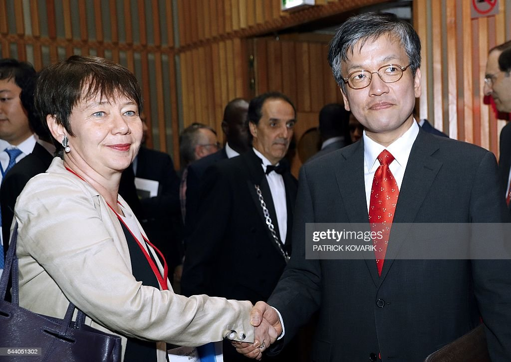 Deputy chairman of French public investment bank La Caisse des Depots (CDC) and Secretary General of Club de Paris Odile Renaud-Basso(L) shakes hands with Korean vice-minister of strategy and finance Sang Mok Choi during 60th anniversary of the Paris Club, on July 1, 2016 in Paris. KOVARIK