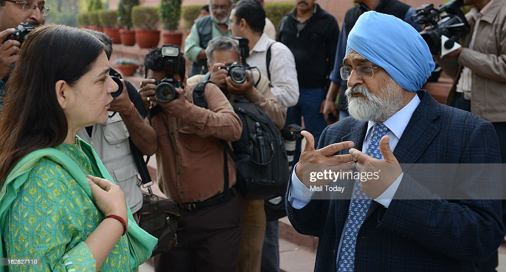 Deputy Chairman of Planning Commision Montek Singh Ahluwalia with Menka Gandhi during the ongoing budget session at Parliament House on Wednesday.