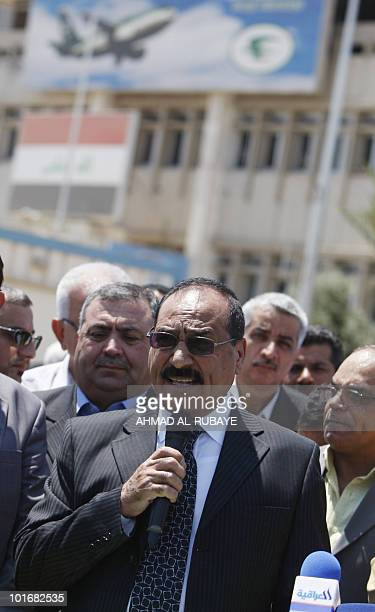 Deputy chief executive of Iraqi Airways Nasser Hussein bandar addresses protesters during a demonstration at Baghdad airport on May 5 2010 against...