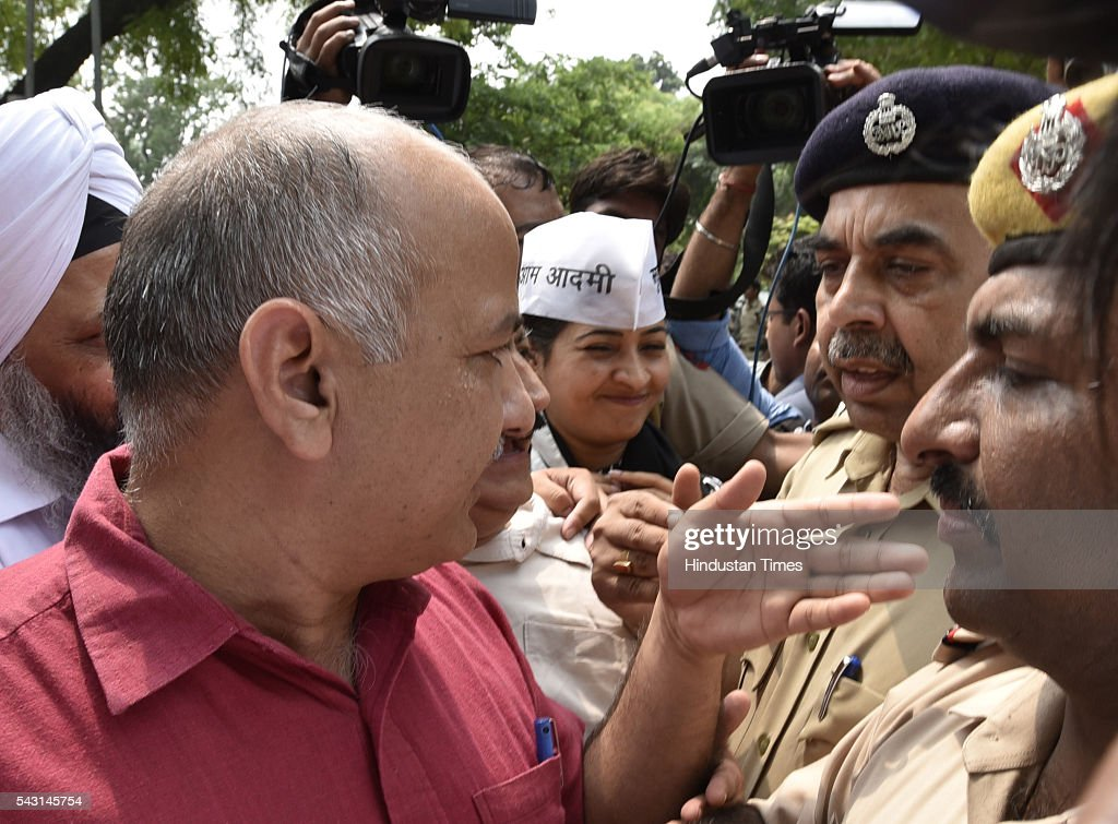 Deputy Chief Minister Manish Sisodia and with 51 other Aam Aadmi Party MLAs detained while they were marching towards the Prime Minister's residence to protest against the arrest of Sangam Vihar MLA Dinesh Mohaniya and the Centre returning their Bills, on June 26, 2016 in New Delhi, India. The planned protest was scheduled a day after AAP MLA Dinesh Mohaniya's arrest and the consequent Emergency remark made by Delhi Chief Minister Arvind Kejriwal. Earlier on Sunday, Delhi chief minister Arvind Kejriwal said Manish Sisodia would surrender to PM after some vegetable vendors complained against the deputy CM, his latest offensive against Narendra Modi following the arrest of a party MLA a day earlier.