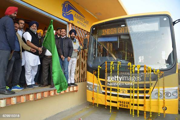 Deputy Chief Minister of the northern Indian state of Punjab Sukhbir Singh Badal waves a flag during the inauguration ceremony of the first phase of...