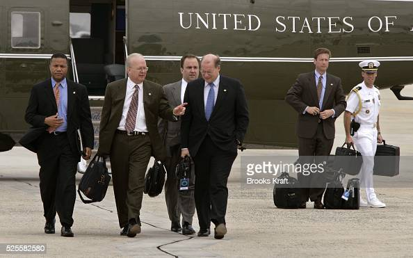 Deputy Chief of Staff Karl Rove center walks towards Air Force One on the way to Indianapolis with President Bush July 14 2005 Press Secretary Scott...