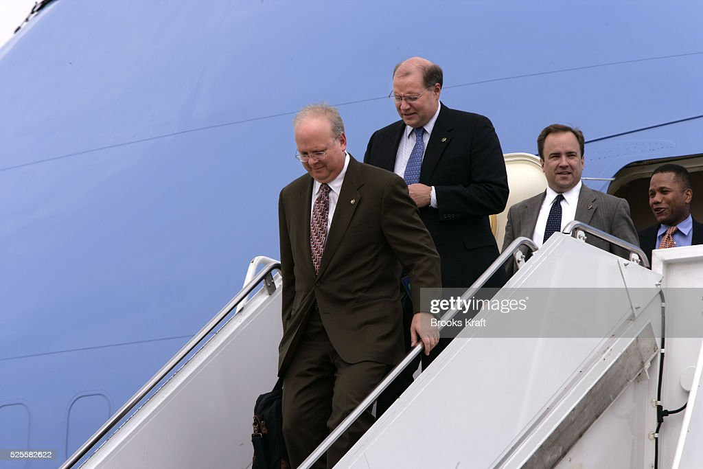 Deputy Chief of Staff Karl Rove left arrives on Air Force One at Andrews Air Force Base after returning from Indianapolis with President Bush July 14...
