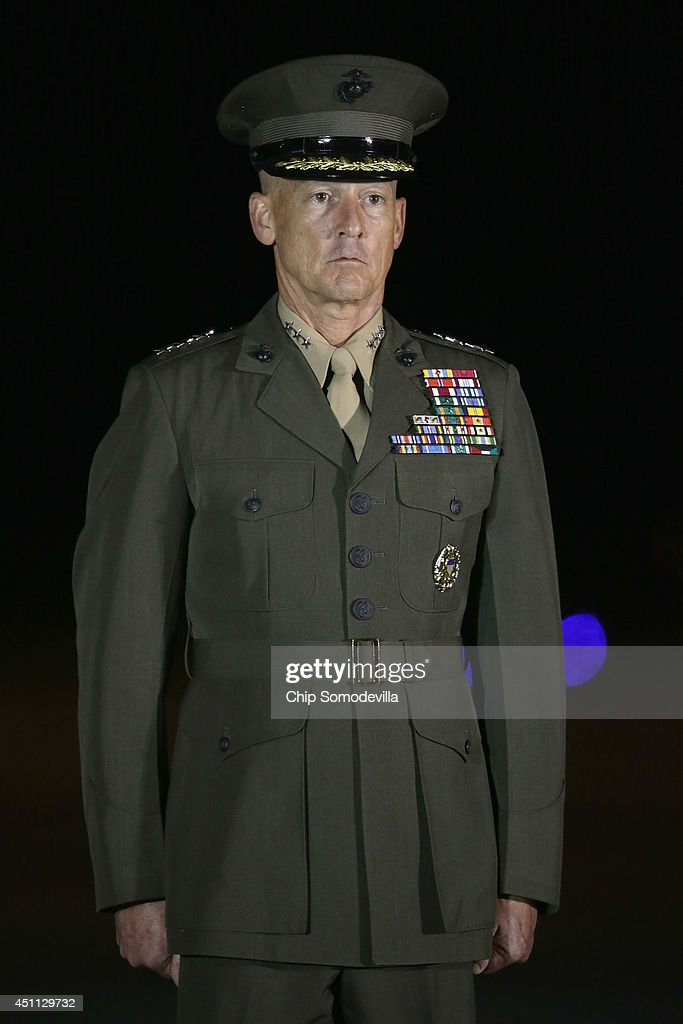 Deputy Commandant of the Marine Corps Lt. Gen. <a gi-track='captionPersonalityLinkClicked' href=/galleries/search?phrase=William+Faulkner&family=editorial&specificpeople=214195 ng-click='$event.stopPropagation()'>William Faulkner</a> participates in the dignified transfer of the remains of three Marines at Dover Air Force Base June 23, 2014 in Dover, Delaware. Members of the 2nd Combat Engineer Battalion, 2nd Marine Division, II Marine Expeditionary Force at Camp Lejeune, Staff Sgt. David Stewart of Stafford, Virginia; Lance Cpl. Brandon Garabrant of Peterborough, NH; and Lance Cpl. Adam Wolff of Cedar Rapids, Iowa were killed Friday when their vehicle was struck by a roadside bomb in Helmand province in southern Afghanistan.